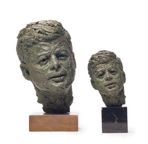 TWO PATINATED PLASTER BUSTS OF JOHN F. KENNEDY – est. $800 – 1,200