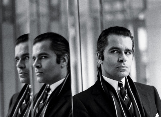 "Karl Lagerfeld in mirror, mid-1970s ""Karl always surrounded himself with talented people who fed him ideas. Like Machiavelli, he manipulated them, and sometimes would back them financially and lavish them with extravagant gifts. Karl has always been known for his generosity. He was a loner, a huge book collector, and he was obsessed with competing with Yves Saint Laurent when he was designing at Chloé, way pre-Chanel. He was always a fashion genius."""