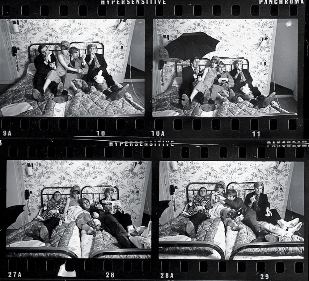 """Andy Warhol and gang, 1965 """"These shots were taken at a raucous romp during a trip Andy Warhol and his Factory pals took to Paris for his second solo exhibition there. They posed in bed and in the bathroom of the Hôtel Bourgogne, next door to my Glamour office. The whole crew showed up pretty regularly in Paris in the mid-to-late 1960s. Andy, who is not wearing his trademark platinum wig in this photo, was not well known in France then, but his fame was growing. He was always looking for rich clients who wanted their portraits done. Andy, Edie Sedgwick and the rest of his entourage spent every night at nightclubs, including Le Sept, Castel's and Regine's with a cast of French aristos, models, handsome gigolos and essentially anyone good-looking enough to get in the front doors."""""""