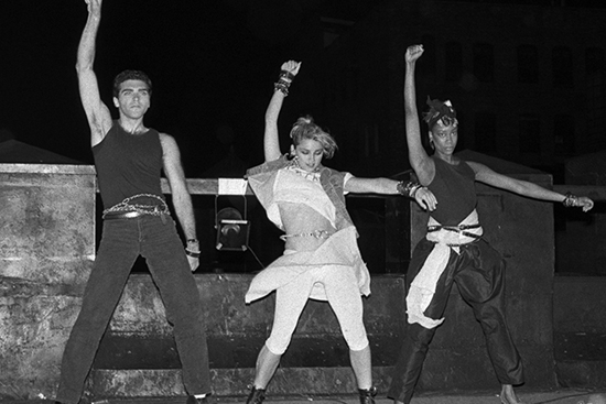 Madonna with brother Christopher (left) on the roof at Danceteria in '83. Photo, Bob Gruen