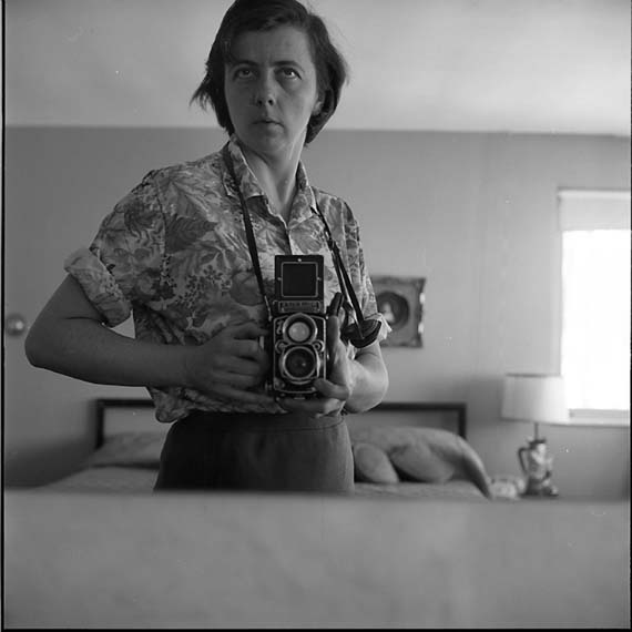 vivian_maier_highland_park_il_self_portrait_bedroom_mirror_1965.jpg