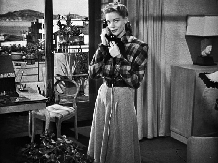"""Bacall's apartment """"Dark Passage"""" was set in 1360 Montgomery Street. In the movie, the exterior view across Irene's patio is a photo backdrop used on the studio soundstage to set the location. In the real apartment at 1360 that view would look east across the Bay towards Yerba Buena Island…"""