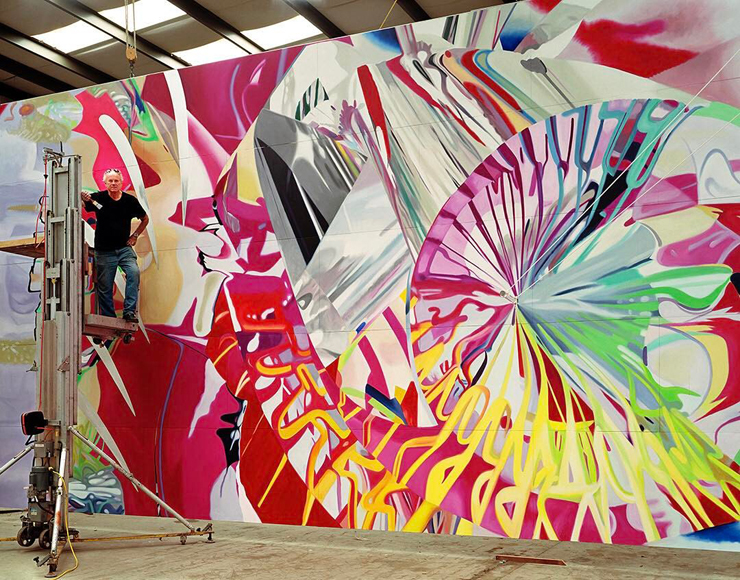"James Rosenquist, Aripeka, FL, February 2003, with his 17×22' painting ""Joystick,"" 2002. Photo, Todd Eberle"