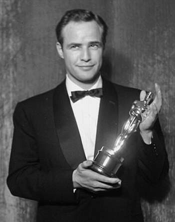 Brando with his Oscar that Leo had to give to the Feds. It's OK. He's got his own