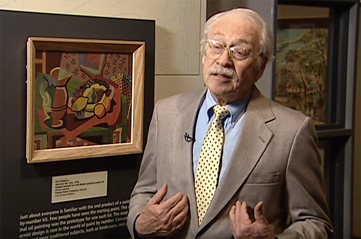 """Robbins at the Smithsonian exhibit in 2001 with his """"Abstract No. 1"""", his first paint by number creation"""