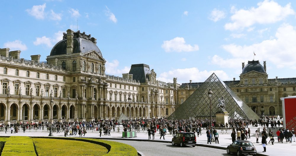 """Pei decided that a pyramid was """"most compatible"""" with the other structures at the Louvre, complementing their roofs' faceted planes."""