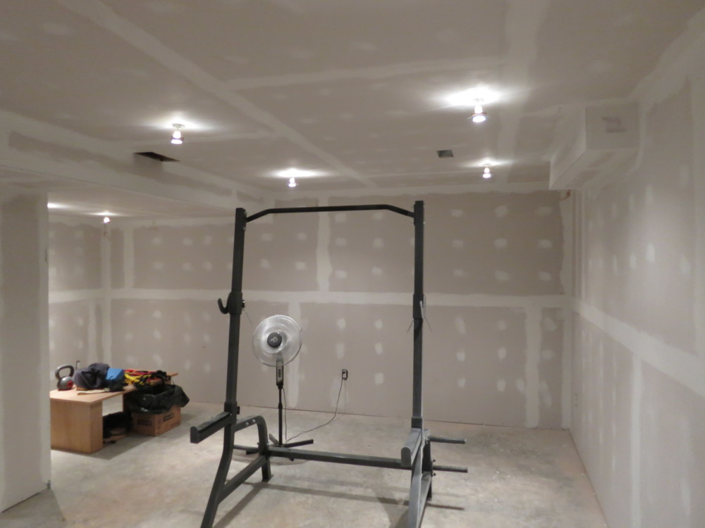 Finally, in early 2014, I got back to work on the workout room. These next few photos are after the mudding and sanding is completed.