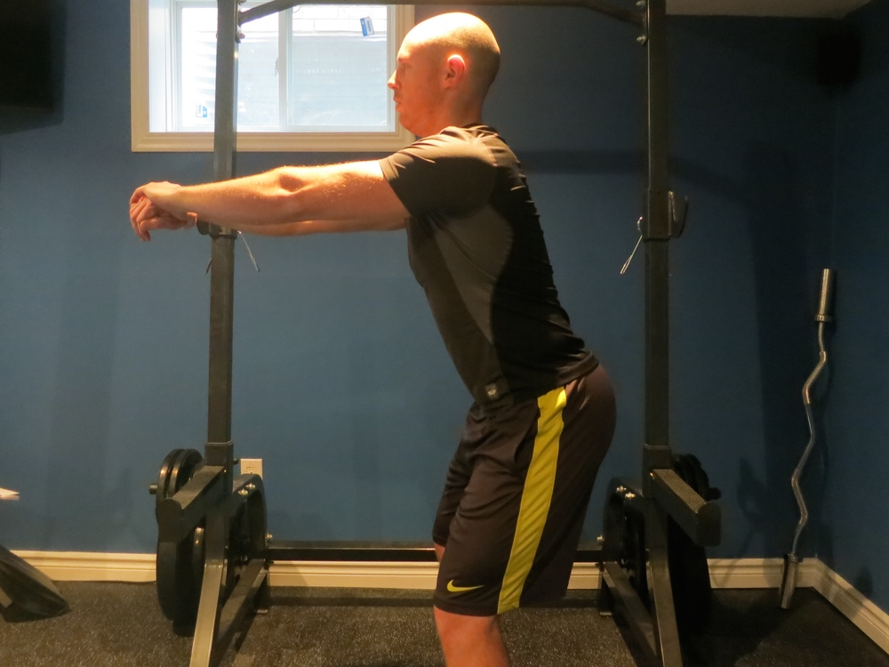 Initiate the squat through the hips, pushing the hips back and down. The knees will naturally bend as your hips begin to move.