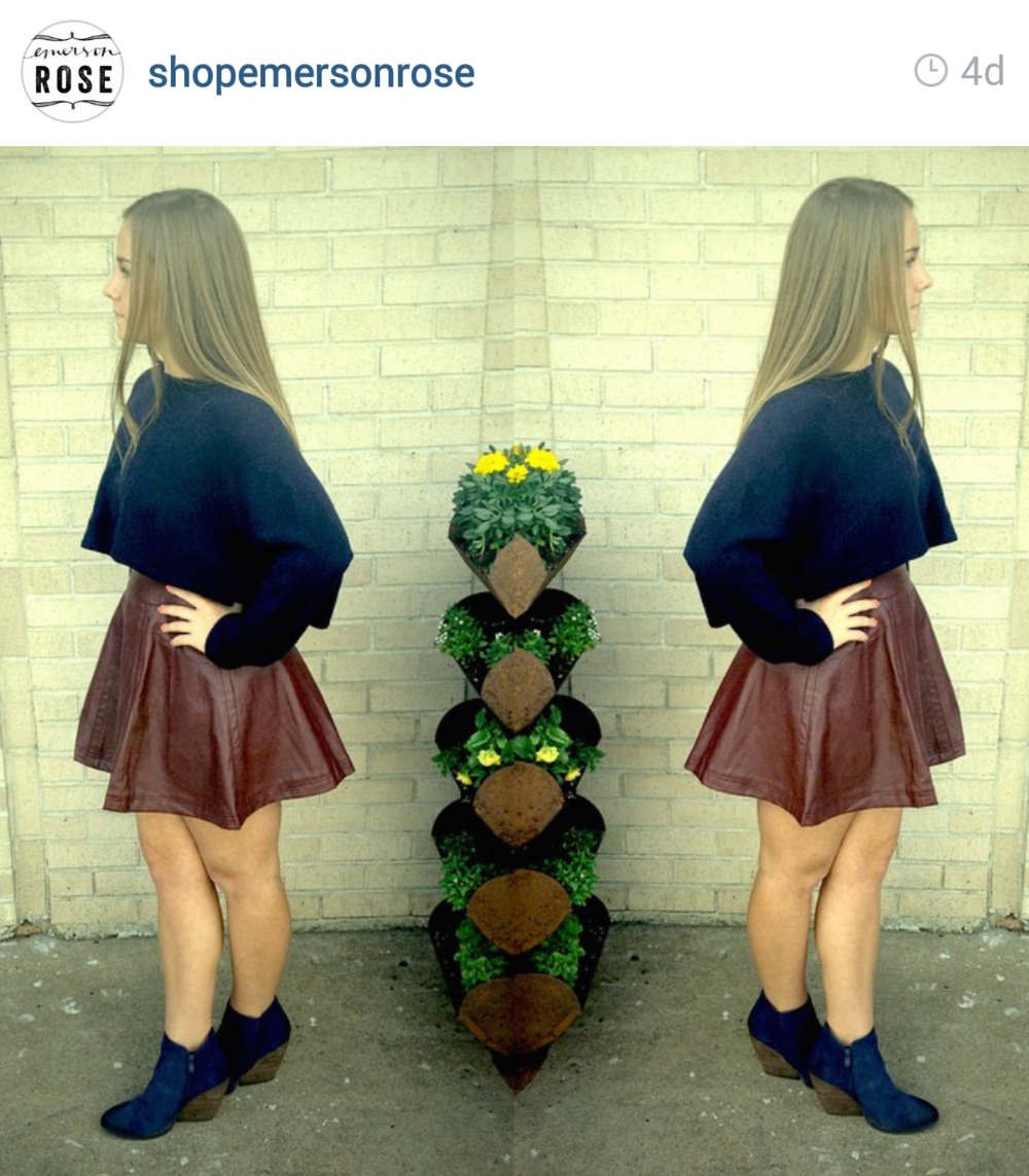 Shopemersonrose wearing our crop top. This crop top looks adorable with the burgundy leather skirt.