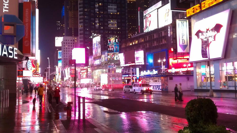 Times Square, rain-slick and empty, during Monday night's storm.