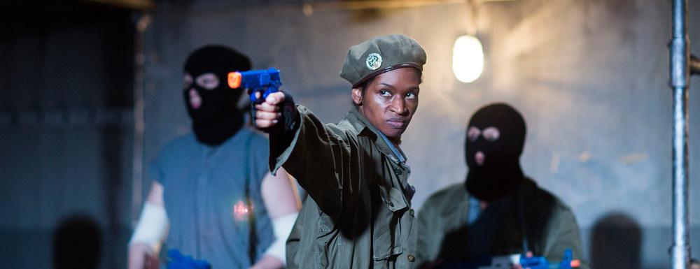 Jenny Jules, mit pistol, fromJulius Caesar (Image courtesy Donmar Warehouse.)