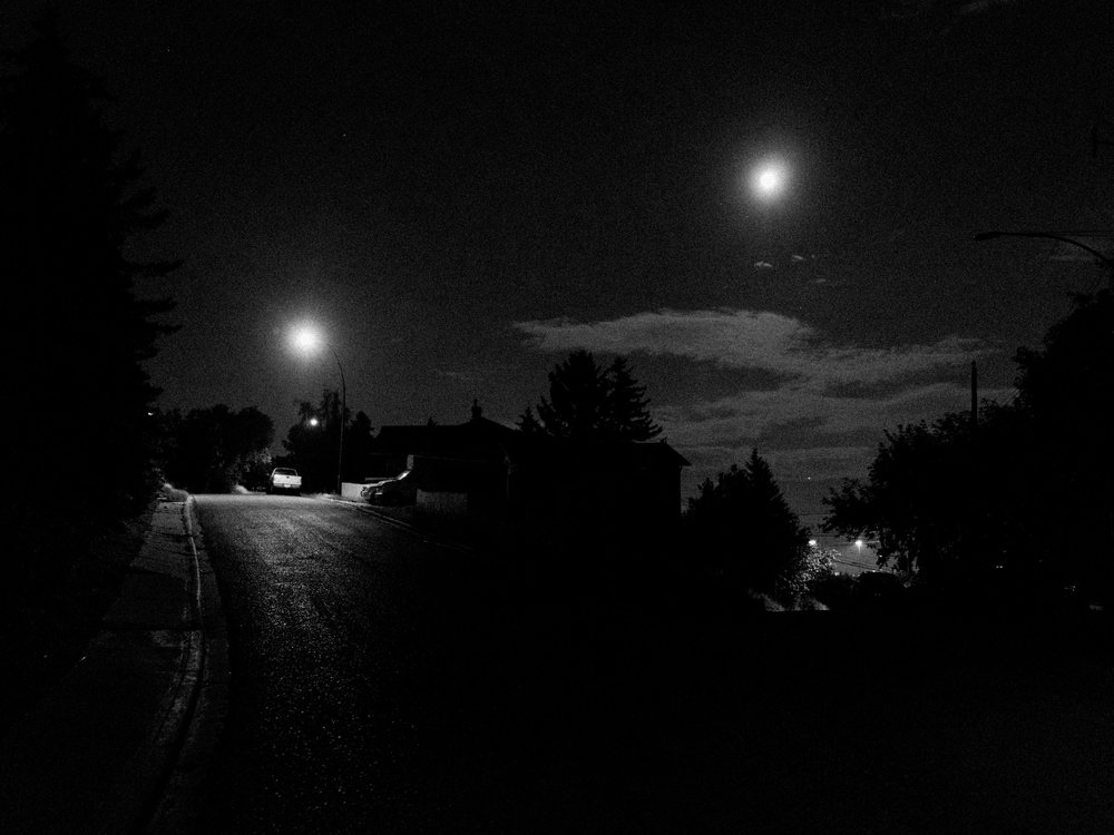 I love how the repetition turned out in this one. The road branches, and on one side is the streetlight and on the other side is the the moon. I recognize the luck in this photo. The moon isn't always in this position and it's an essential part of this photo.