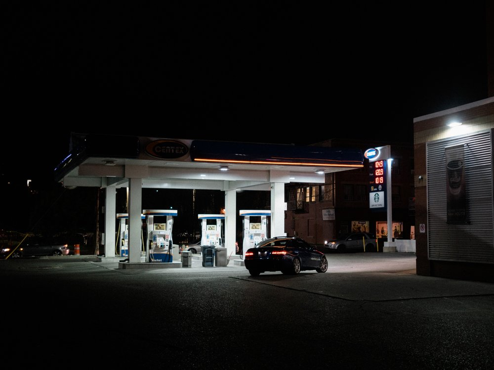 "I have a small series of ""gas stations at night"" photos. I love the little beacons of light set against a plain backdrop."
