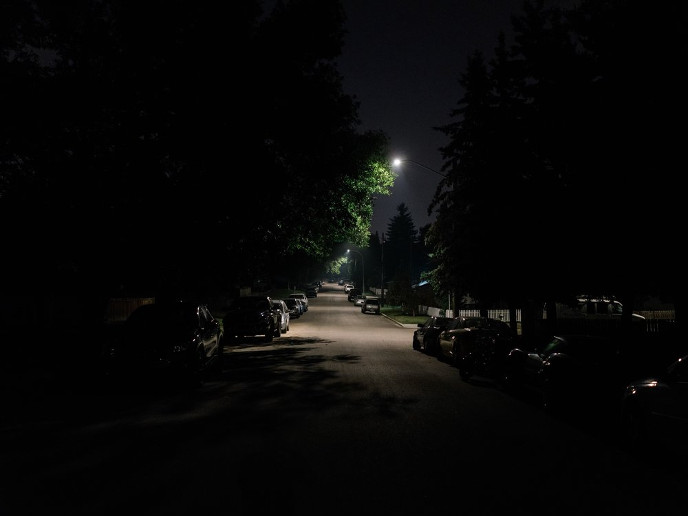 This particular street didn't have a sidewalk so I walked down the middle of the road. I loved the canopy of trees with the streetlights dotting the way forward. When it's this late at night, the roads are quiet and the traffic is rare.