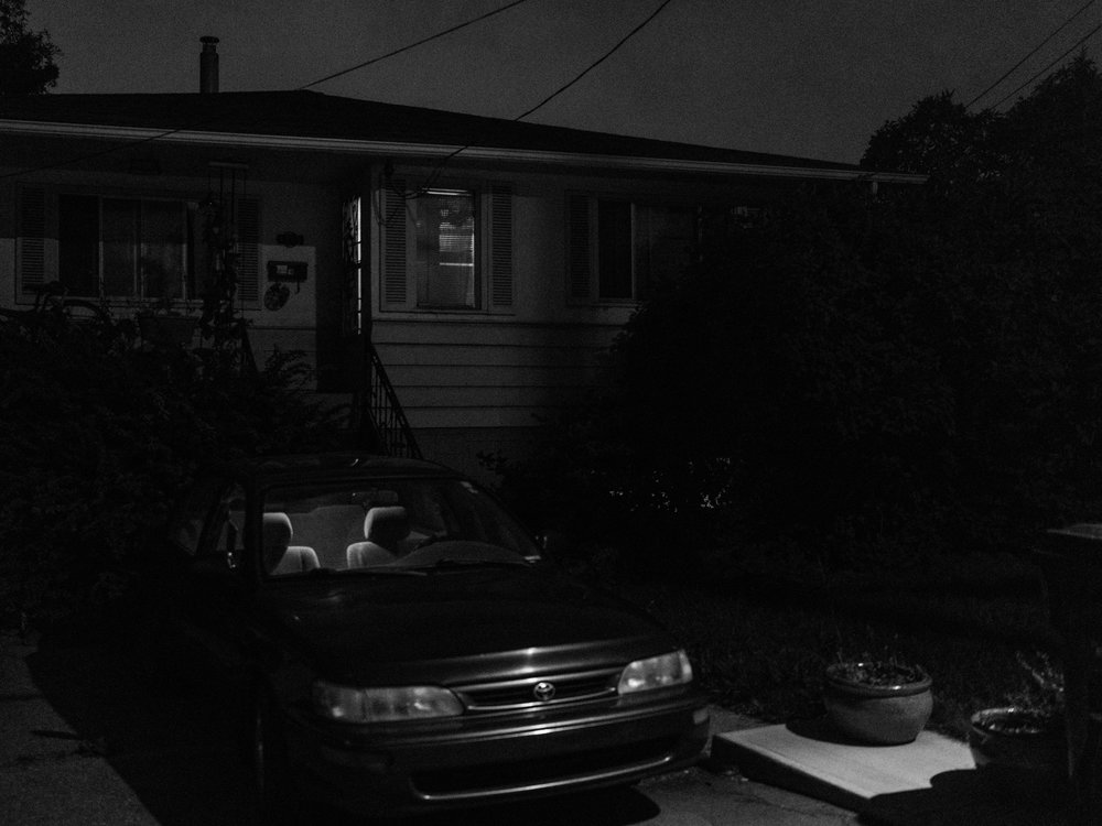 There was a better photo here but I missed the opportunity. I walked by and noticed the door of the car and screen door of the home open. The whole scene was dramatic. I was about to lift the camera to my eye but I noticed someone rustling around in the back seat of the car. I already feel like a creep walking around taking photos at night, and capturing someone in this vulnerable position made me feel bad.