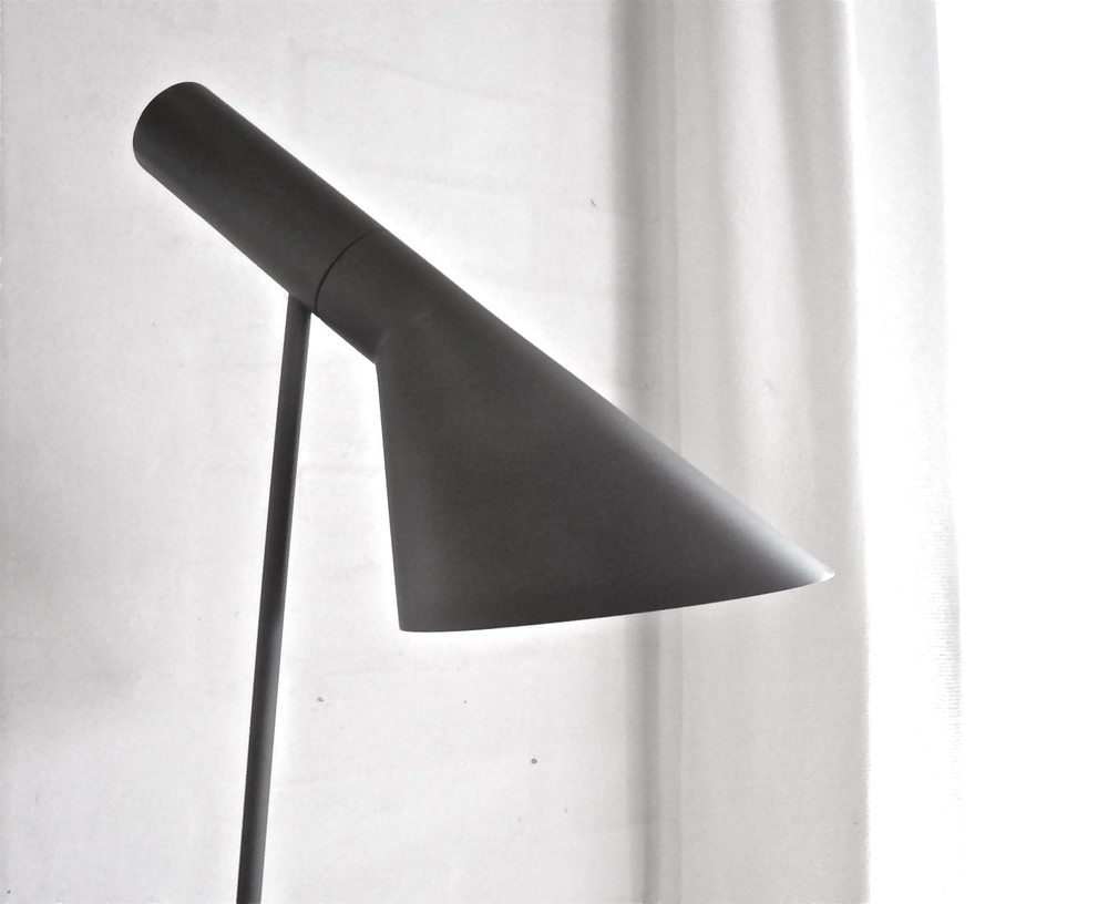 Danish Architect Arne Jacobsen designed this lamp in 1957.  Here it is doing it's job at Juul's Bolighus in Sonderberg DK.