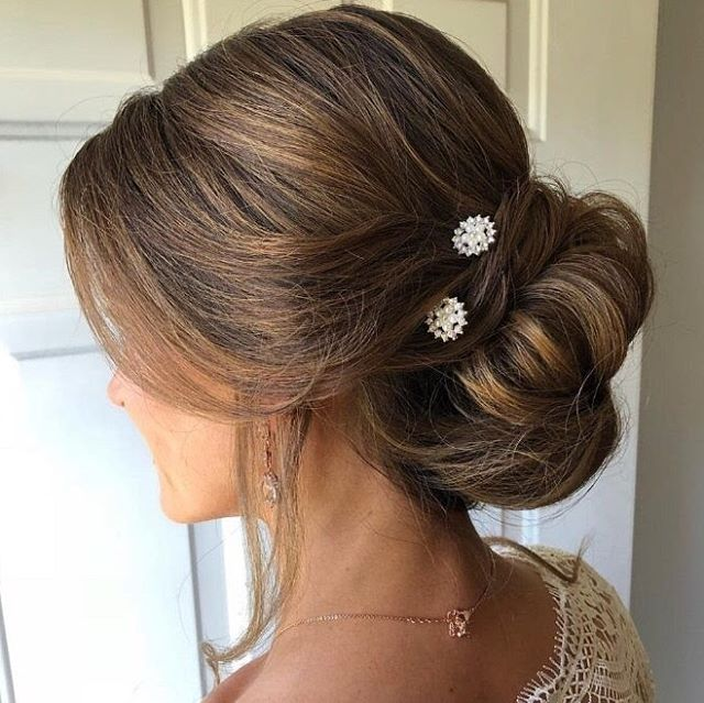 Looking for a stunning updo on your wedding day?  The stylists at TOMORROWS want you to feel pretty on your big day! Call us at 440-333-5056 to schedule a bridal consultation. . . #weddinghair #updo #prettyhair #tomorrowssalon