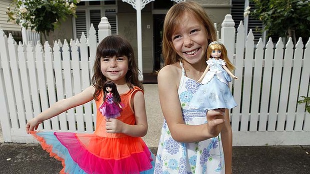 Healthier: Genevieve Bland and Caitlin Dooley with their Lottie dolls, which can stand and wear practical clothes. Photo: Melanie Faith Dove.
