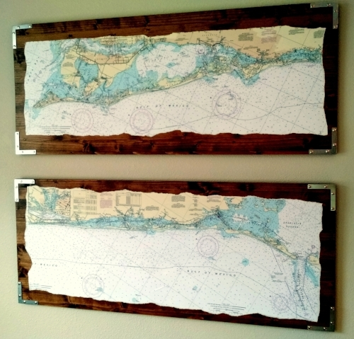 Bought long boards from home improvement store then hand ripped some nautical charts and decoupaged them onto the boards.  Added some metal corner decorations.  Yes, the lower one looks crooked because of the way I ripped it . . . Carson said it gives it character!