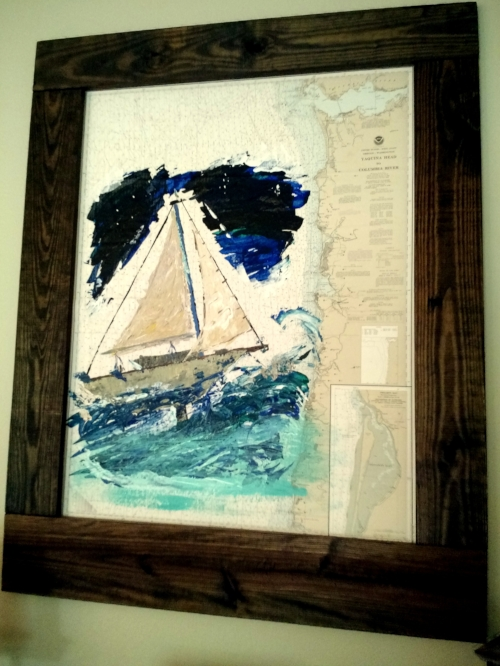 This takes some talent.  Kris took an old nautical chart and painted, but then we just used regular boards from the home improvement store and made a simple rustic frame.