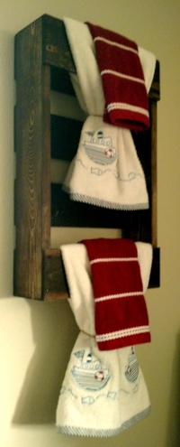 Took half pallet and made cute rustic towel holder for Carson's bathroom.
