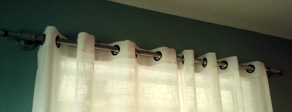 Everyone has seen these galvanized pipe diy curtain pipes.  Well, they do work and I love them!