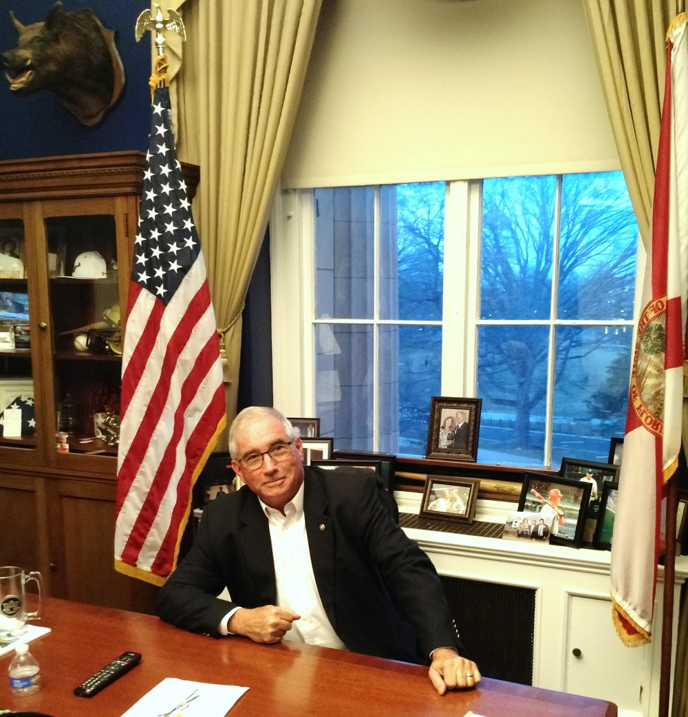 Kris taking over the Congressman's desk