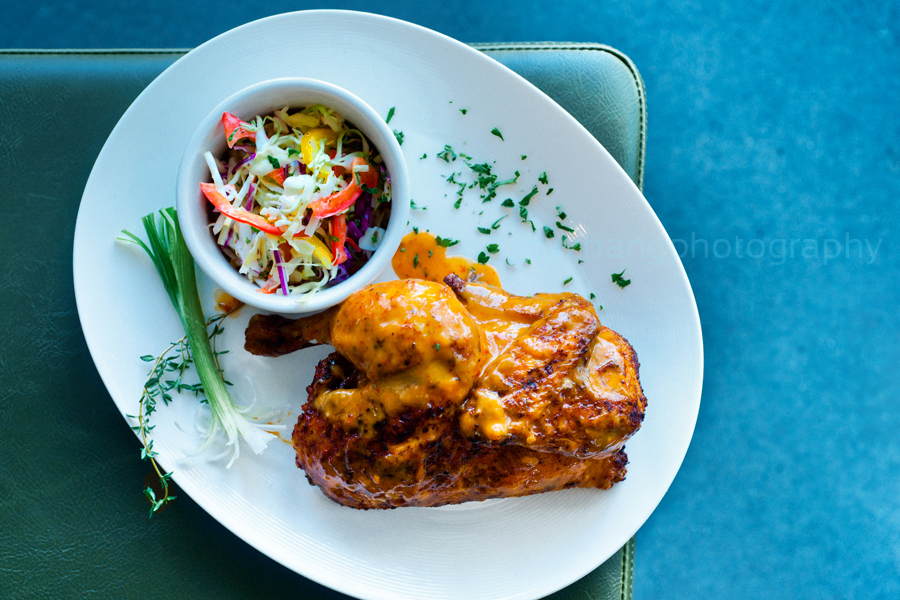Nazca Roasted Half Chicken, flame glazed with an Aji Pepper sauce