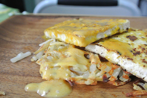 seared tofu and sunny coconut-roasted pepper sauce over waffled hash browns.jpg
