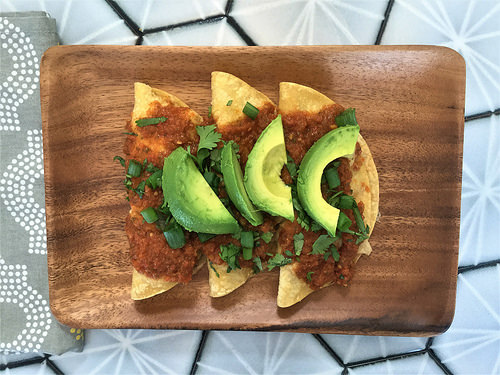 polenta and black bean enchiladas with tomato sauce and avocado plate.jpg