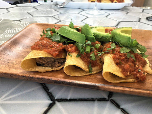 polenta and black bean enchiladas with tomato sauce and avocado detail.jpg