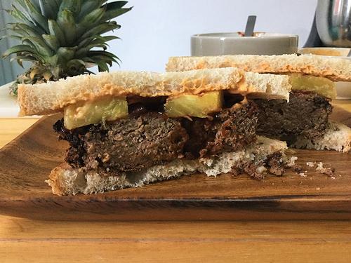 bbq tofu-pecan loaf sandwich with pineapple and smoky tahini sauce cross section.jpg