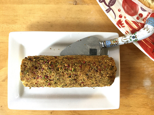 party animals no 52 almond pate log with pistachios and pink peppercorns.jpg