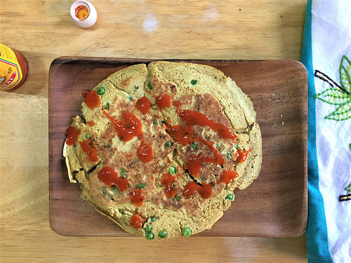 jumbo savory chickpea-rice pancake with hot sauce.jpg