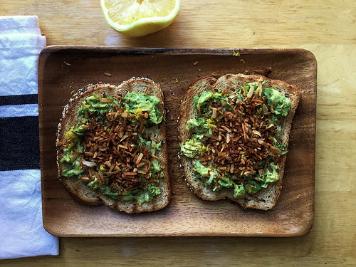 dead simple zucchini toast with avocado, lemin zest, and coconut bacon table.jpg