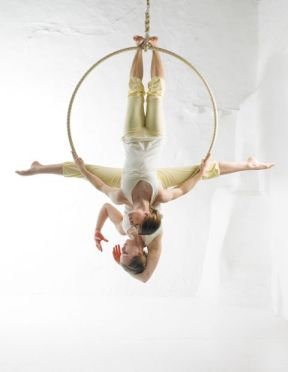 Aerial Hoop, Aerial Cerseau, Luftring Lilli and Sara offer aerial circus entertainment for events. They are specialised in aerial hoop and aerial silks. This picture shows them on the hoop. They offer bespoke solo aerial performances and are also happy to choreograph ensemble aerial silk and hoop shows.