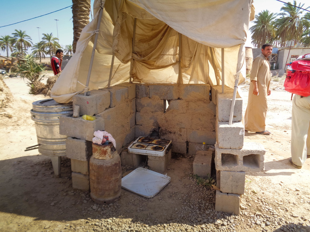 Multiple families share this cooking area. The camp managers at this site, who are themselves displaced, are trying to gather donations to establish communal kitchens.