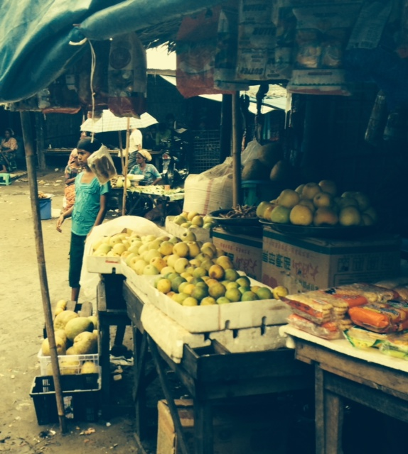 "Despite their terrible situation, the Rohingya have built a community in the camps. This market is one example of their efforts. Rekhine merchants sell them the produce. ""Business is going well for the Rakhine,"" according to one of the Rohingya."