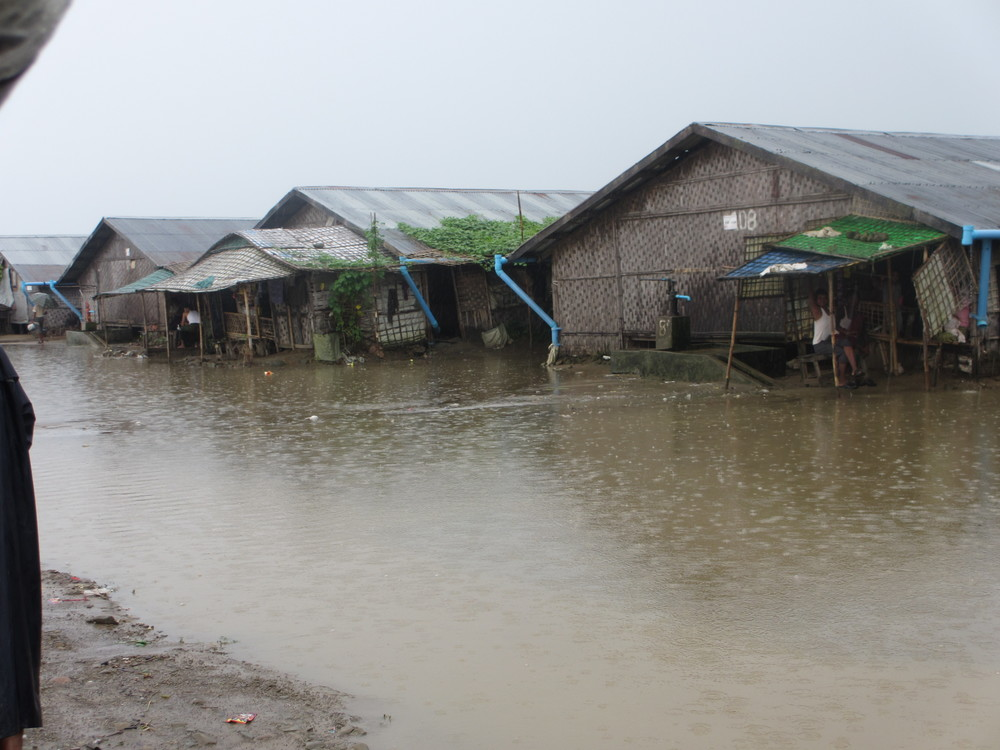 RI went to Myanmar at the end of the rainy season, and this photo was taken after just an afternoon's worth of rain. The shelters in displacement camps were built to be temporary and provide no meaningful protection from the rain.