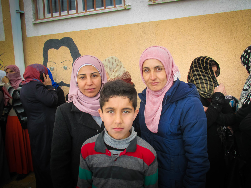 These sisters and one of their sons arrived from Syria recently. They registered for temporary protected status but still could not access services, so they are now asking a local NGO for help. Sanliurfa, Turkey.