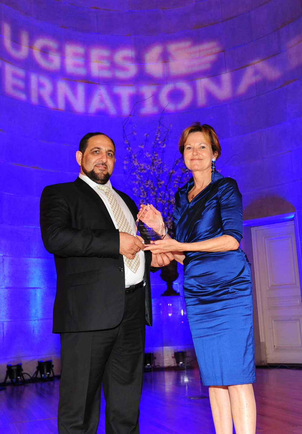 Dr. Seri Bakkar receives Richard C. Holbrooke Leadership Award from Kati Marton