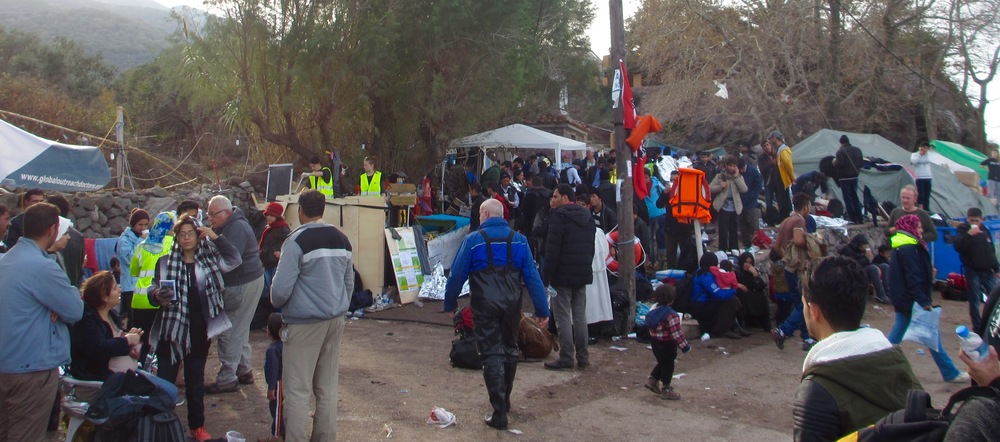 Refugees receive hot broth and a change of clothes and shoes.