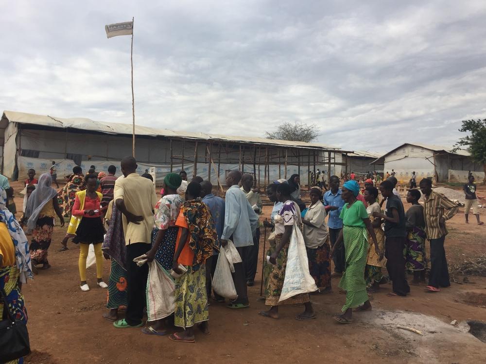 Burundian refugees line up for a distribution in Mahama camp, Rwanda.