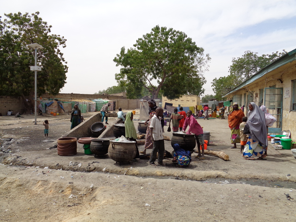 The majority of those displaced (IDPs) by Boko Haram in Borno state are living in the capital, Maiduguri. There are several state-run IDP camps throughout the city. This picture shows one of just three cooking areas for more than 5,000 people living in one of the camps.
