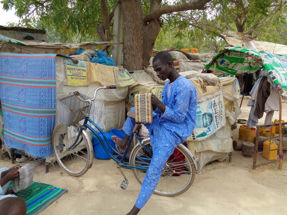 The support that the IDPs in the camp receive is inconsistent and inadequate. Many, like this young man, have turned to sewing handicrafts for sale in the local market to try to earn a meagre living.