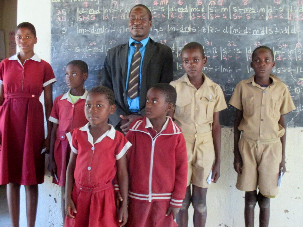 A teacher and his students at a school in Binga District in Matabeleland North, one of the poorest and driest regions of the country. Many children here go to school on empty stomachs and are noticeably unable to concentrate.