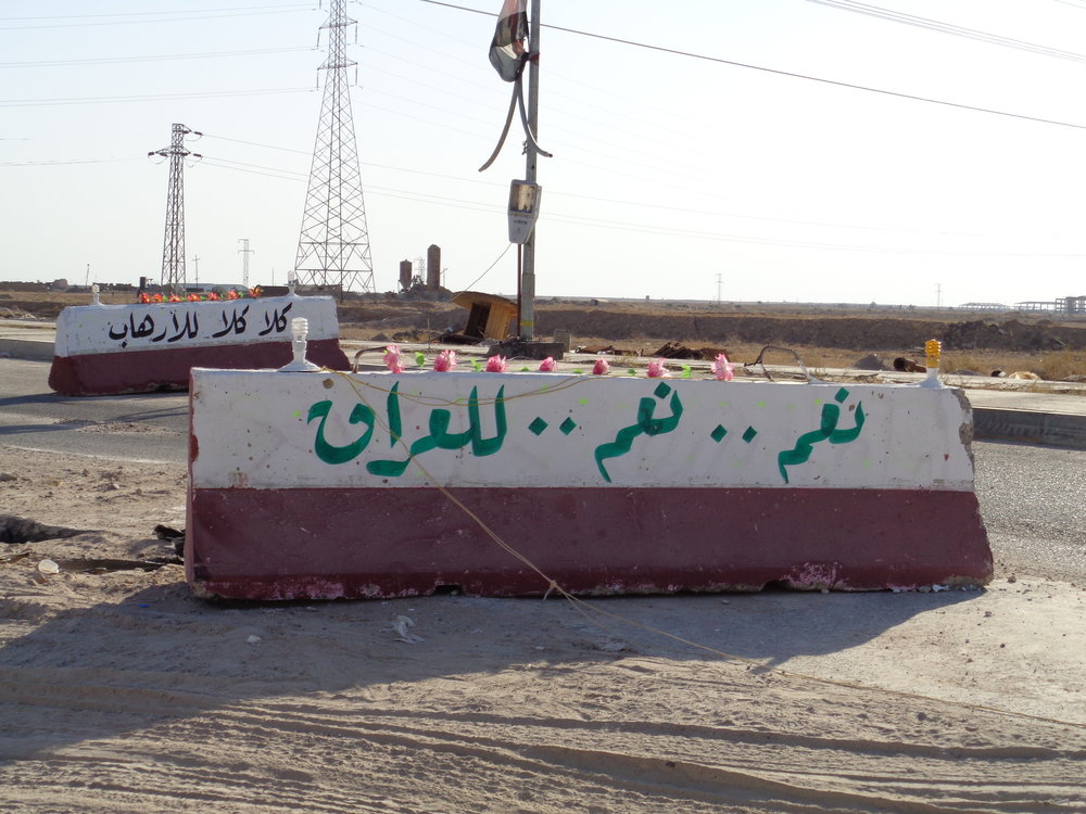 "Roadblocks at the entrance to the town read, ""Yes, yes to Iraq. No, no to terrorism."" Both ISIS's barbarism and the anti-ISIS military campaign continue to uproot Iraqi families. And even where ISIS no longer operates, the physical and social damage left behind will take years to heal."