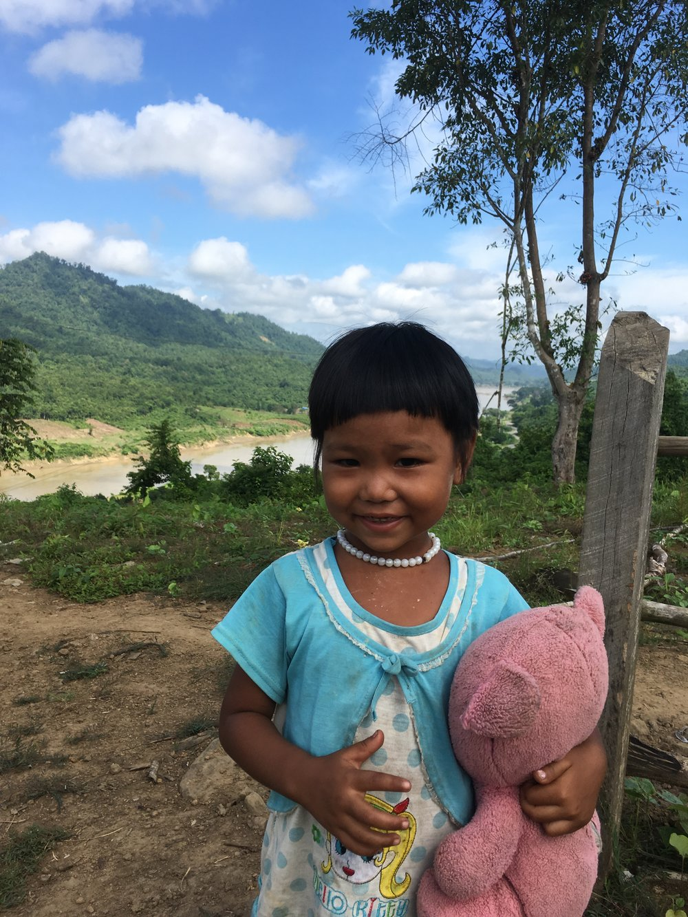 Displaced for over six months by flash floods in Myanmar's Saigang Region, this little girl and her family are one of hundreds relocated by the government to higher ground.