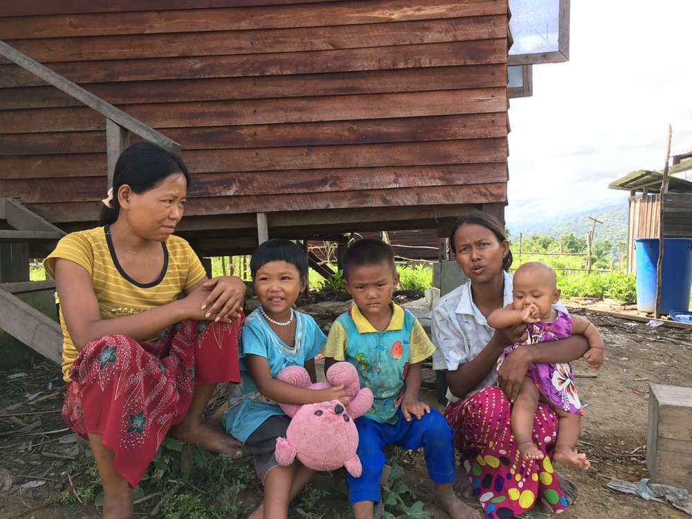 When RI visited this area of Sagaing Region in September 2015, these families were living in tents along a roadside, their homes having been washed away by flash floods. Now, one year later, they have been relocated away from the river to government-owned land and are living in new homes built with support from international donors. They feel safer in their new homes, but the new site is situated along a steep mountainside far from the main road, creating numerous challenges.