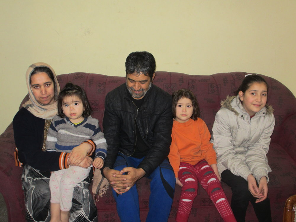 One of the biggest challenges faced by refugees and asylum-seekers in Turkey is finding housing. Many live in crowded houses and struggle to pay for heat and rent. Pictured here is a family of Afghan refugees living in Kayseri.